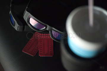 3-D glasses and movie tickets