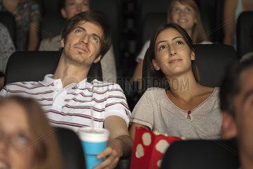 Couple enjoying movie in theater