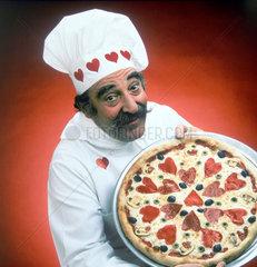 Herzchen auf der Pizza