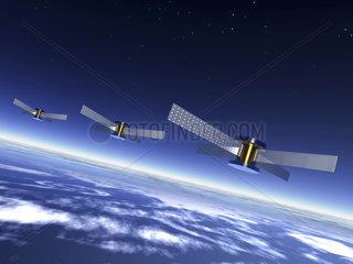 3 Satelliten im All ueber der Erde