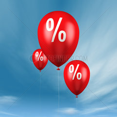 Ballons mit Prozentzeichen vor blauem Himmel - balloons with percentage sign in blue sky