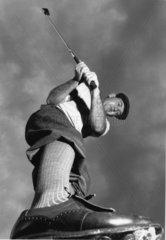 Golfspieler aus Froschperspektive