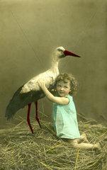 Maedchen mit Storch