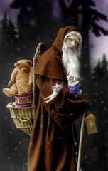 Weihnachtsmann mit Teddybaer