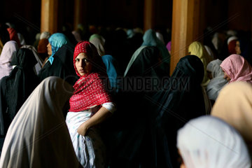 Believers pray at the Jama Masjid mosque