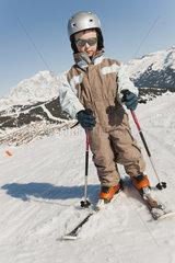 Boy in ski-suit  full length portrait