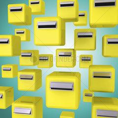 Gelbe Briefkaesten auf gruenem Hintergrund - yellow letter boxes or mailboxes
