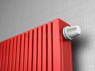 Roter Heizkoerper mit Thermostatventil - Energie sparen