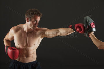 Barechested boxer sparring