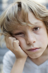 Boy with bored expression on face  portrait