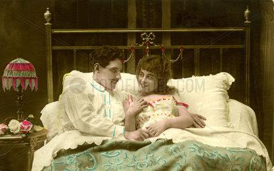 Ehepaar in Bett