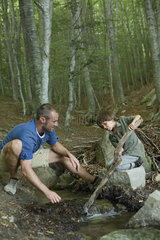 Father and son playing in woods