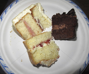 Slices of cake on paper plate