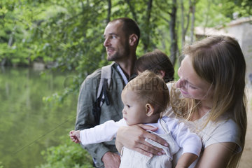 Family in woods  focus on mother holding baby girl