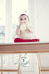 Infant drinking milk from bottle