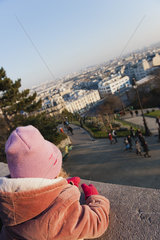 Little girl looking at view of city  Montmartre  Paris  France