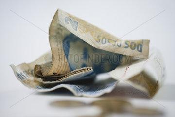 Crumpled Argentine pesos