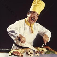 Japanische Koch lacht