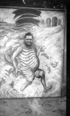 Mann steckt Kopf durch Bild  1940