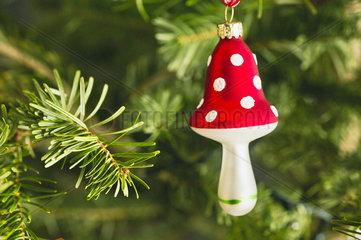 Mushroom shaped Christmas ornament on tree