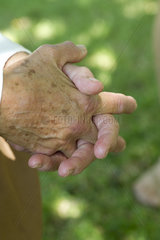 Elderly person's clasped hands