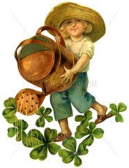 Junge giesst vierblaettrigen Klee  Glueckssymbol  Oblate  1902