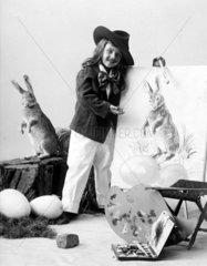 Kind mit gemaltem Osterhasen