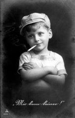 Junge raucht  1920