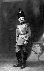 Kind verkleidet als Soldat  1900