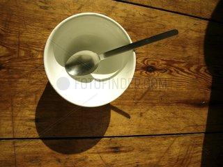 Tasse mit einem Loeffel