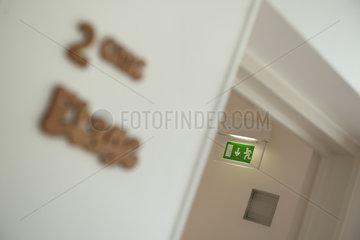 Emergency exit sign in corridor