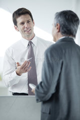Businessman discussing work with colleague