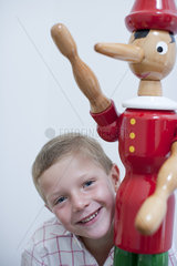 Boy and toy figurine
