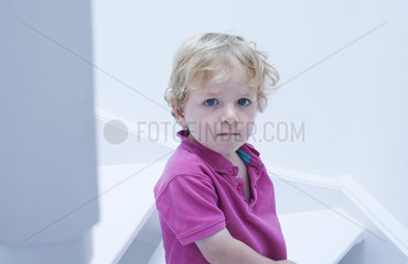 Little boy biting lips  portrait