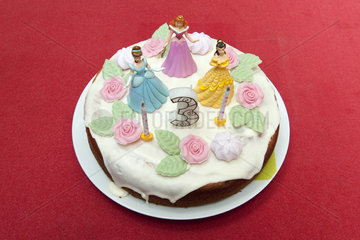Birthday cake for three year old decorated with princess figurines