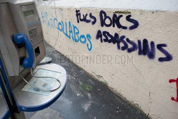Graffiti painted on wall near payphone