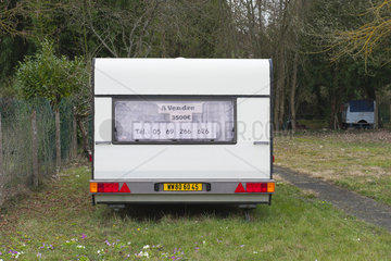 For sale sign and telephone number posted on trailer