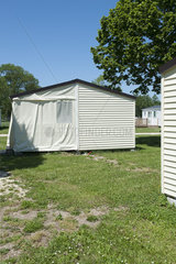 House with porch covered by tent flaps