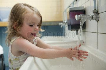Little girl washing hands