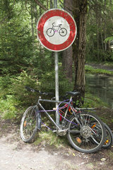 Bicycles locked to bicycle path sign