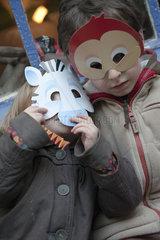 Children wearing animal masks  portrait