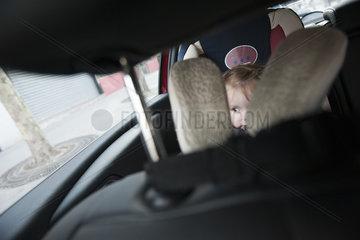 Little girl sitting in car seat