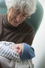 Grandmother holding newborn baby