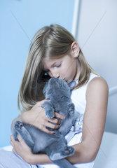 Girl kissing pet cat  portrait