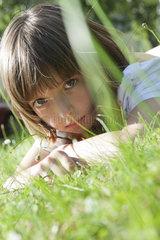 Girl lying in grass  portrait