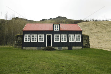 Typical Icelandic house with red roof  Iceland