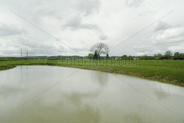 Artificial lake in a rural landscape