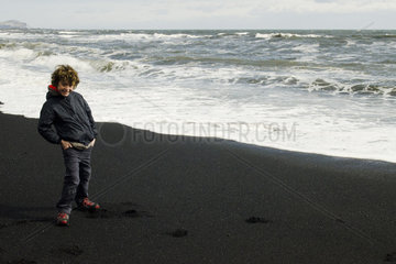 Smiling boy on beach iceland