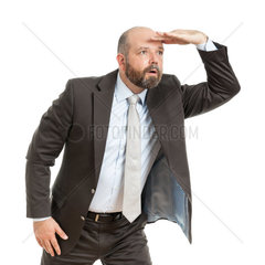Ein motivierter Geschaeftsmann vor weissem Hintergrund