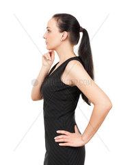 Eine tuechtige Geschaeftsfrau vor weissem Hintergrund